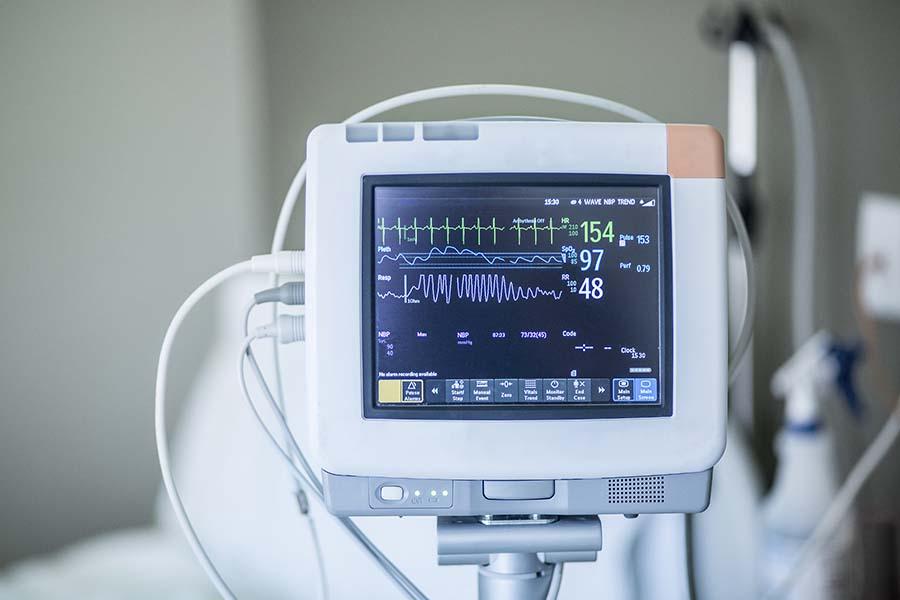 Gehäuse für ein Bildschirm aus dem Bereich Medizintechnik mit abgebildetem Herzschlag